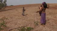 Stock Video Footage of Ethiopia: Poor Ethiopian Girls Skip