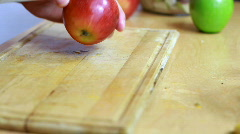 Slicing apple - Preparing fruit salad close-up Stock Footage