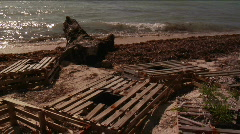 Lobster traps on a beach Stock Footage