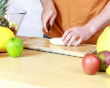Slicing bananas - Preparing fruit salad Stock Footage