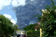 Oil refinery explodes - Smoke from oil refinery on fire 2 Stock Footage