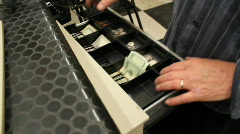 Counting money from a cash register Stock Footage