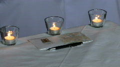 Stock Video Footage of Marriage Certificate on table at wedding reception with candle burning