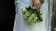 Bride holding wedding bouquet in hand with wedding ring Stock Footage