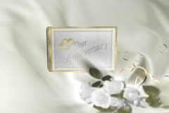 5910L Our Anniversary Gold Hearts White Satin Flowers Album book opening - stock footage