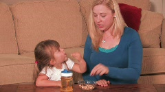 Mother & Child Eating a Snack - stock footage