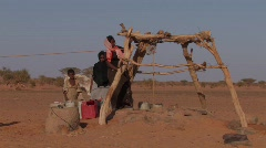 Sudan: Woman Collects Water  Stock Footage