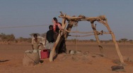 Stock Video Footage of Sudan: Woman Collects Water