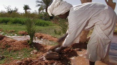 Sudan: Man Works in Irrigation Canal - stock footage