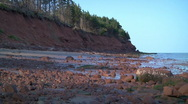 Stock Video Footage of Red sand cliff and stony beach