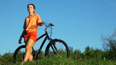 Woman with bicycle in summer field Stock Footage