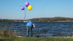 Boy on coast with balloons Stock Footage