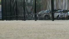 many people walking by fence at ballpark - stock footage