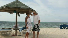 Couple standing and chatting Stock Footage