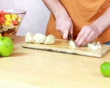 Slicing pomelo - Preparing fruit salad Stock Footage