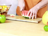 Slicing watermelon - Preparing fruit salad Stock Footage