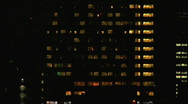 Office Building At Night with Artistic Blur Stock Footage