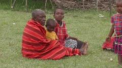 Kenya: Old Massai Woman and children - stock footage