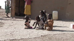 Sudan: Poor children in a IDP camp share a bowl of cereal - stock footage