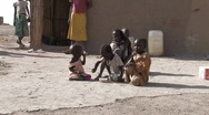 Stock Video Footage of Sudan: Poor children in a IDP camp share a bowl of cereal