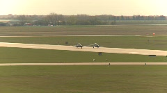 Military aircraft, Harvard-II x2 takeoff from tower Stock Footage
