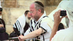A jewish believer putting phylacteries (tefillin) - stock footage