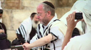 Stock Video Footage of A jewish believer putting phylacteries (tefillin)