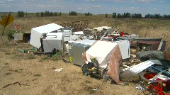 The environment, garbage dump, #34 with appliances, pan Stock Footage