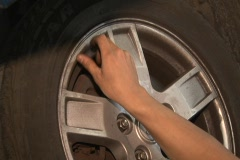 Auto mechanic checking tire air pressure Stock Footage