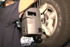Stock Video Footage of Auto mechanic making a wheel alignment