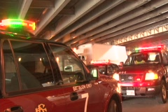 Emergency vehicles parked under the highway bridge - stock footage