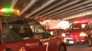 Stock Video Footage of Emergency vehicles parked under the highway bridge