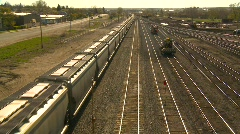 Railroad, unit train, covered hoppers through yard, #2 Stock Footage