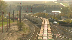 Railroad, Freight train, unit train, covered hoppers through lights Stock Footage