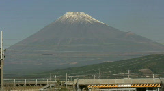 Shinkansen trains pass Mount Fuji Stock Footage