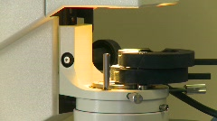 Tilt down microscope and test strip Stock Footage