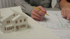 Close up of people going over architecture plans Stock Footage
