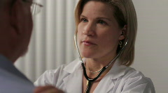 Female Doctor with patient, closeup Stock Footage
