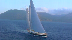 A magnificent aerial shot over a large sailboat at sea. Stock Footage