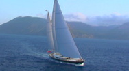 Stock Video Footage of A magnificent aerial shot over a large sailboat at sea.