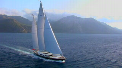 An aerial over a magnificent sailing boat on the open ocean. - stock footage