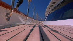 A low angle shot of the deck of a boat. Stock Footage