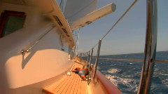 The wake of a boat as seen from the side of a ship. Stock Footage