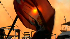 The flag of the Cayman Islands flies behind the sun. Stock Footage