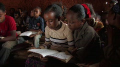 Ethiopia: Two girls share a textbook in a school in Ethiopia Stock Footage