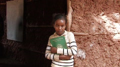 Ethiopia: Student in doorway of her classroom - stock footage
