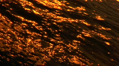 Sunset reflection on the hull of a sailboat docked in the harbor. Zoom out. Stock Footage