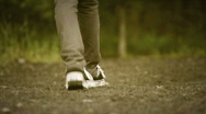 Stock Video Footage of girl walking on path