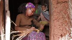 Ethiopia: Girl weaves basket Stock Footage