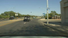 Motorcycle group - 1 - waiting for traffic to go by for left turn Stock Footage